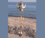 Metal teapot wind chime with shells