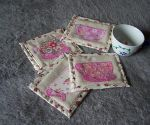 Coasters with tea cup